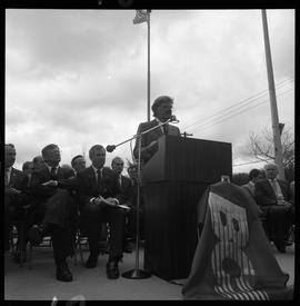Merger of BCIT and PVI celebrations April 1986; man talking at outdoor podium [1 of 4 photographs]