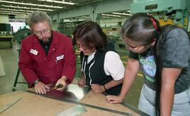 Pre-trade Aboriginal women; sheet metal, students and instructor in class [5 of 12 photographs]