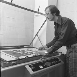 BCVS Graphic arts ; man positioning a poster in a Nuarc plate maker [1 of