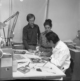 BCVS Graphic arts ; three people at a desk discussing graphic designs [2 of 3]