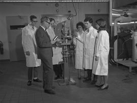 Food Processing Technology, 1966; instructor showing a group of students a piece of food processi...