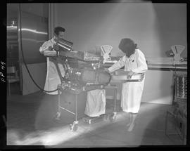 Food Processing Technology, 1966; two people in a lab coats using food testing equipment (image b...