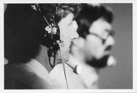 Broadcast Communication, 1980s(?); man wearing a headset, another man in background