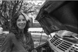PVI Automotive Mechanics ; Kathryn Love standing next to the open hood of a car [2 of 4]