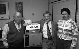 Applied Technology Training Centre staff members (?) posed with boxes [1 of 3 photographs]