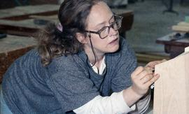 BCIT Women in Trades Training; carpentry, woman marking wood [1 of 3 photographs]