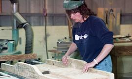 BCIT Women in Trades; carpentry, woman with saw wearing face shield