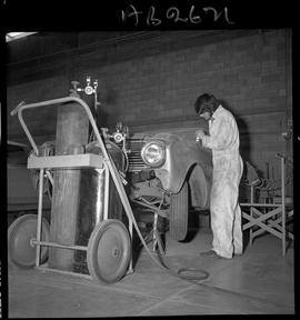 BC Vocational School image of Autobody program student working on a vehicle in the shop [4 of 5 p...