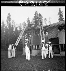 B.C. Vocational School; Carpentry Trades students setting up ladders to  access the roof of a sma...