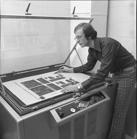 BCVS Graphic arts ; man positioning a poster in a Nuarc plate maker [2 of