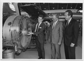 Wynne Powell, John Watson, Peter Oveck Maett. Canadian Airlines jet engine donation. May 1992