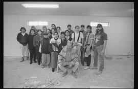 Coast Salish youths, BCIT students and instructor (?) posing for a group shot during gym construc...