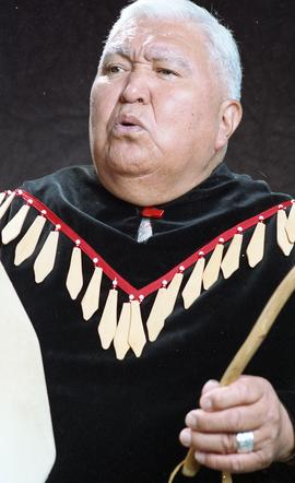 Bob George, First Nations elder, in First Nations garment playing an instrument [24 of 36 photogr...
