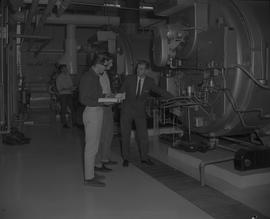 Stationary engineering, Terrace, 1968; men standing in a maintenance room with large machinery [1...