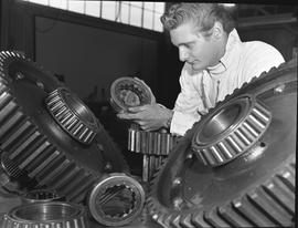 BCVS Heavy duty mechanic program ; man looking at a gear ; display of large and small gears