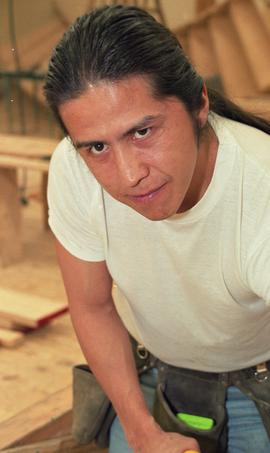 First Nations student wearing a tool belt and using a woodworking tool [10 of 13 photographs]