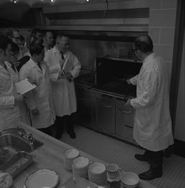 Hotel Motel Restaurant Administration Program; instructor showing students a grill