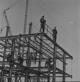 Structural steel, 1971; men working on a steel structure [3 of 3]
