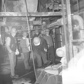 Forestry, Wood fiber BCIT tour, November 26, 1965; men in hard hats in a factory