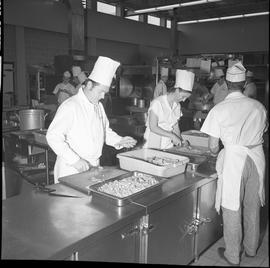 BC Vocational School Cook Training Course ; two students chopping carrots ; students preparing fo...