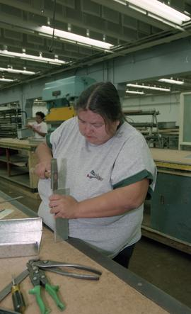 Pre-trade Aboriginal women; sheet metal, students using materials and equipment in class [8 of 11...