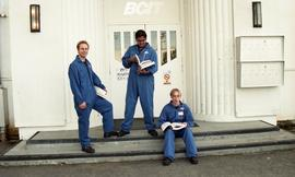 Aviation, students in uniforms holding books while standing outside a BCIT building [7 of 10 phot...