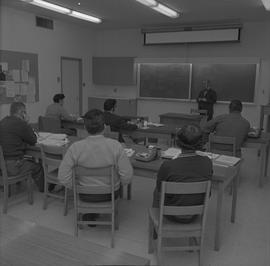 Time keeping, Nanaimo; instructor lecturing to a classroom of students [1 of 2]