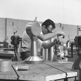 B.C. Vocational School, Sheet metal work course ; student building an engine order telegraph ; en...