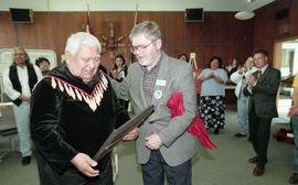 BCIT open house '98, staff member presenting a framed photo to a First Nations elder [3 of 5 phot...