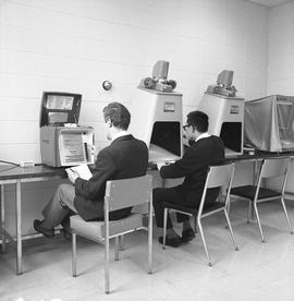 BCIT Library ; two students using microfilm readers [4 of 4]