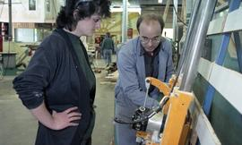 BCIT Women in Trades; carpentry, two people looking at machine