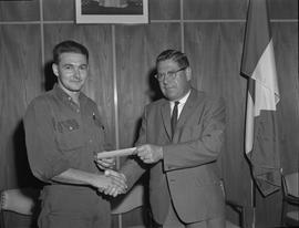 Welding, 1967; Presentation to top welding students; student smiling and receiving a cheque