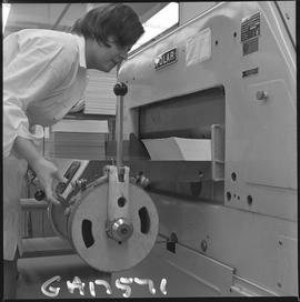 BCVS Graphic arts ; person using a paper cutting machine