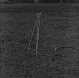 Survey, 1971; a level on a tripod on flat ground [1 of 2]