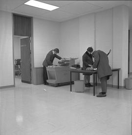 BCIT Library ; student using a photocopier ; students using a hole punches