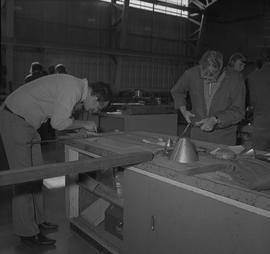 Sheet metal, 1968; student use scissors to cut sheet metal ; student measuring a piece of sheet m...