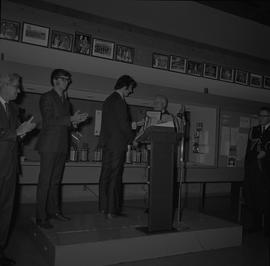 Governor General the Right Honourable Roland Michener presenting a man with an award; BCIT sports...