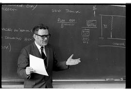 BCIT Business Management image of instructor standing at a blackboard teaching. Early 1970s.