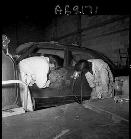 BC Vocational School image of Autobody program students working on a vehicle in the shop [5 of 8 ...