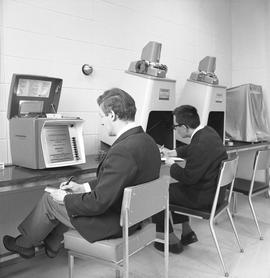 BCIT Library ; two students using microfilm readers [1 of 4]