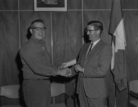 Welding, 1967; Presentation to top welding students; student smiling and receiving a cheque for $25