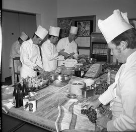 BC Vocational School Cook Training Course ; instructor talking to student ; students preparing va...
