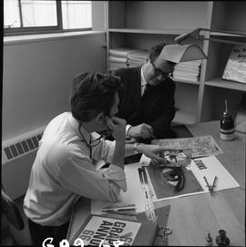 BCVS Graphic arts ; two men sitting at a desk looking at illustrations and lettering [2 of 2]