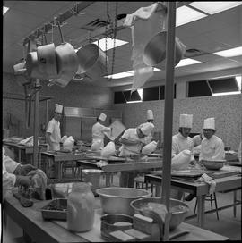 BC Vocational School Baking Course ; students working in the kitchen ; some students looking at c...