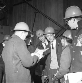 Forestry, Wood fiber BCIT tour, November 26, 1965; a group of men wearing hard hats