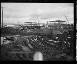 Construction of BCIT in progress, mud field in foreground