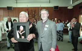 BCIT open house '98, staff member presenting a framed photo to a First Nations elder [4 of 5 phot...