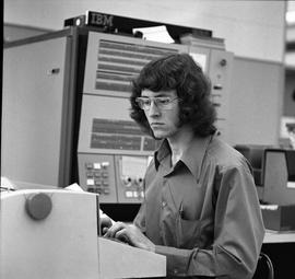 Man typing at IBM 2501 computer, Business Management program