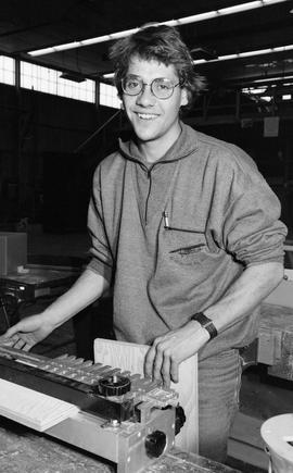 BCIT Carpentry, 1989, man with woodworking machine [1 of 2 photographs]