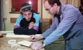BCIT Women in Trades; carpentry, looking at and making marks on wood [1 of 3 photographs]